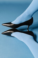 Woman With Black Heels On Blue Background