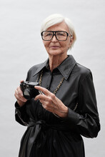 Stylish Senior Woman With Camera