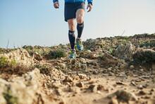 Fit Man Running Along A Rocky ...