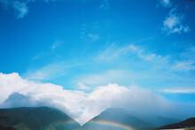 Rainbow Against Blue Sky In Hawaii