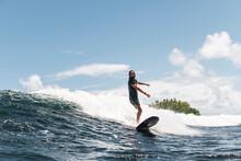 Skilled Surfer On Foamy Wave W...