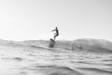 Black And White Photo Of Surfer On Wave In The Ocean