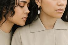 Close Portrait Of Two Women's Faces