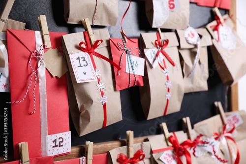 Christmas advent calendar hanging on blackboard, closeup
