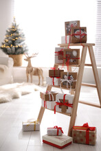 Advent Calendar With Gifts In Room Decorated For Christmas