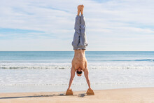 Man In Handstand On Parallel B...