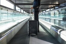 Hipster Male Traveler On Treadmill In Airport