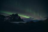Polar lights in clear sky above coastline