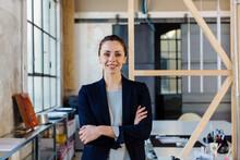 Positive Businesswoman In Crea...