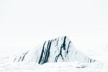 Frozen Mountain Peak In Arctic...