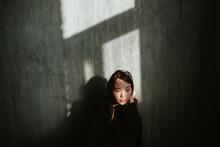 Asian Girl In A Dark Room.