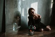 Asian Girl With An Aquarium Fish In A Dark Room.