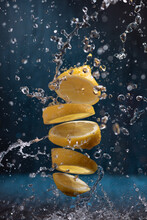 Splash Of Sliced Lemon With Water Drops