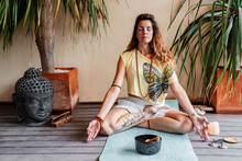 Relaxed Woman Meditating Near Singing Bowl
