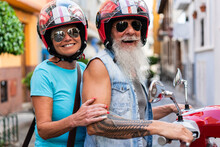 Senior Couple Riding On A Red Motorcycle