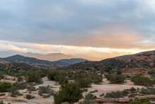 Desert Sunset With Mountains And Clouds At Vasquez Rocks, California