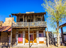 Retro Two Story Western Buildings With Hanging American Flags