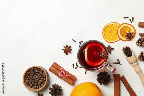 Fototapeta Cup of mulled wine and ingredients on white background obraz