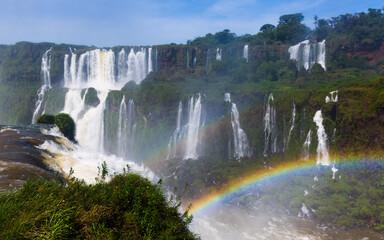 Rainbow over streams of waterfall Cataratas del Iguazu in Iguazu National Park, Brazil