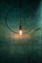 Edison Light Bulb In Dark Vintage Green Room Interior