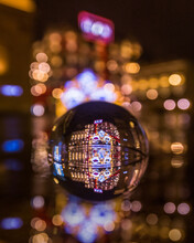 Lens Ball With Christmas Lights Reflected. New Year Christmas Postcard, Bokeh, Shallow Depth Of Field, Reflections, Night City Lights, Christmas Decorations