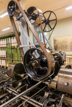 Old Engine In A Textile Fabric With Wheels And Belts