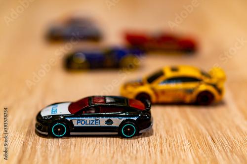 Платно POZNAN, POLAND - Oct 13, 2020: Mattel Hot Wheels toy model Police car
