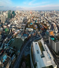 Aerial Panorama From Roppongi Over Downtown Tokyo, With Landmark Tokyo Tower Among Crowded Buildings, City Streets Crisscrossing The District And Tokyo Bay On Distant Horizon On A Beautiful Sunny Day
