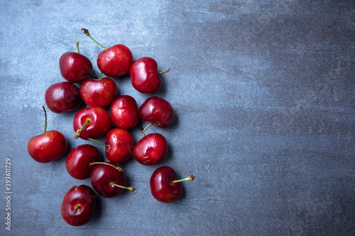 Canvastavla Ripe sweet cherry spread on a blue background