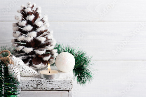 Christmas decoration with pine cone and lit candle Fototapet