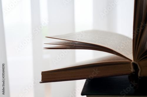 Open book, hardback books on bright colorful background. Fototapeta