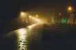 night city lights mysteriously shine through the thick fog