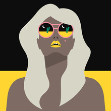 Woman Wearing Sunglasses In The Desert