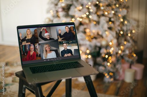 Virtual Christmas tree meeting team teleworking. Family video call remote conference. Laptop webcam screen view. Team meet working from their home offices. Happy hour party online woman team diversity