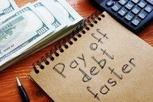 Pay Off Debt Faster Is Shown On The Business Photo Using The Text
