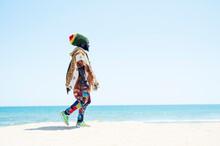 Rastafari Man Walking On Beach