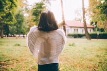 Girl Wearing Angel Wings, Halloween Costume, Rear View