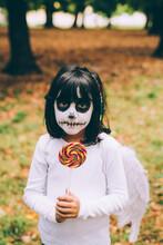 Girl In Halloween Costume With Lollipop