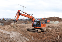 Excavator Dig Trenches At Cons...