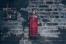 Red Fire Extinguishers And Electrical Panel.