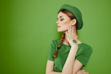 Nice Girl With A Shamrock On Her Hand On A Green Background Holidays St. Patrick's Day Fun Hat On Her Head
