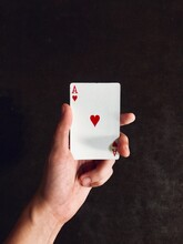 Close-up Of Hand Holding Ace Of Hearts