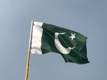 Low Angle View Of Pakistani Flag Against Clear Sky