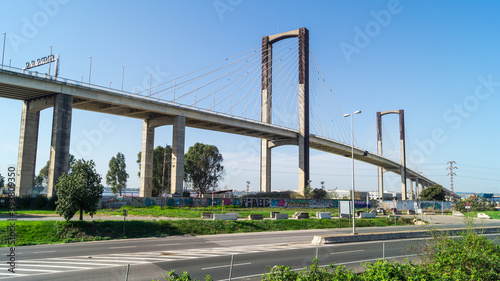 Fotografiet Impressive views of the Quinto Centenario bridge that allows the passage of the SE-30 highway over the Guadalquivir river in Seville (Andalusia, Spain)