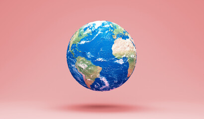 Miniature Earth Planet on pink studio background