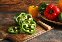 Bell Pepper, Knife And Cutting Board On Table