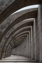 Concrete Structure In The Shape Of Arches And The Silhouette Of A Person