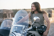 35 Years Old Long Haired Men On His Sidecar Looking Out Of Frame. Jaen, Spain.