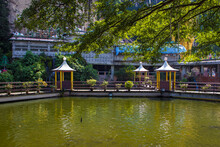 Pond With Artificial Waterfalls On The Background Of A Hindu Temple In The Batu Caves Complex, Kuala Lumpur, Malaysia