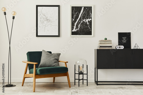 Retro and minimalist compositon of living room interior with design armchair, two mock up poster map, lamp, decoration, white wall and personal accessories. Template. Modern home decor.